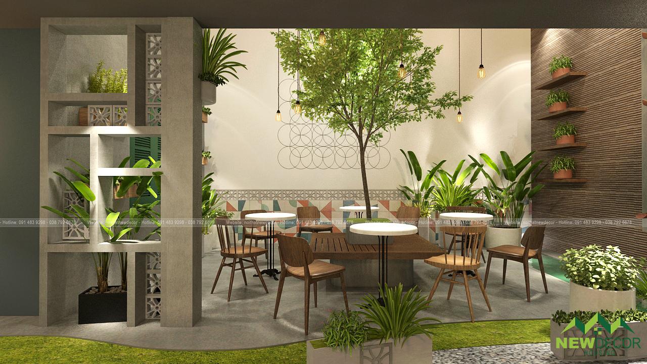 Những bộ bàn ghế gỗ được đặt quanh gốc cây. Không gian nội thất quán cà phê rất thích hợp cho việc học tập, nghỉ ngơi, hay tán gẫu.